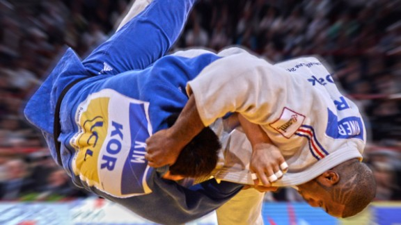 """""""This shot is in for a number of reasons. Teddy Riner is now unquestionably the greatest judoka of all time. Double Olympic and nine-time world champion (he's going for his tenth in November), so he had to be in my list for that. This is also in Paris, in front of his home crowd at the Grand Slam. It's a massive Uchi Mata (one of judo's classical techniques) and it's not all that often you see the men in the +100kg (some of them upwards of 150kg) launched so high and with such precision."""""""
