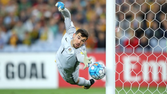 SYDNEY, AUSTRALIA - OCTOBER 10: Mathew Ryan of Australia saves a goal during the 2018 FIFA World Cup Asian Playoff match between the Australian Socceroos and Syria at ANZ Stadium on October 10, 2017 in Sydney, Australia.  (Photo by Cameron Spencer/Getty Images)