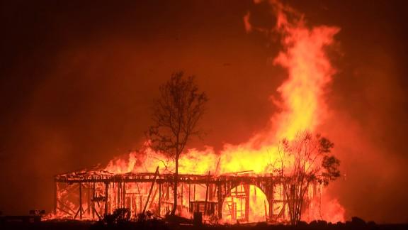 A historic barn burns in Santa Rosa on October 9.