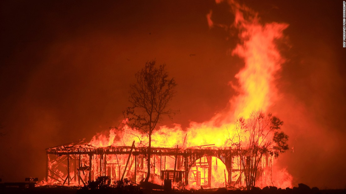 A historic barn burns in Santa Rosa on October 9.