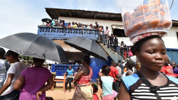 People waiting patiently outside a polling station in Monrovia to cast their votes.  Credit: Getty images