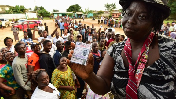 A woman shows her voting card during the elections.  Credit: Getty images