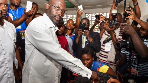 Former international Liberian football star turned politician, and three-time presidential election candidate George Weah casts his vote.   Credit: Getty images