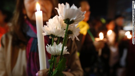 "People hold a candlelight vigil to honor farmers killed during an October 5 protest by coca growers in a rural area of Tumaco, in the southwest Colombian department of Narino, in downtown Bogota on October 9, 2017. The Colombian National Police announced Monday that four members o the police had been suspended for apparently firing into the crowd of protesters, and Colombian President Juan Manuel Santos said he had ordered the police and the army to ""guarantee total cooperation"" with the investigations. / AFP PHOTO / John Vizcaino        (Photo credit should read JOHN VIZCAINO/AFP/Getty Images)"