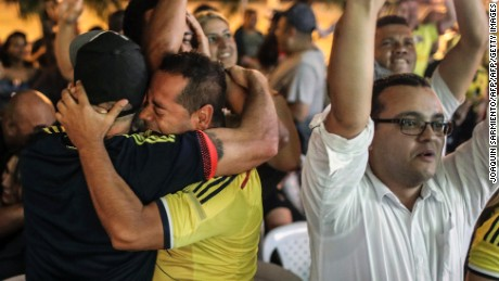 Colombian football fans celebrate in Medellin after their 2018 World Cup qualifier match against Peru ended with a draw and they qualified for the tournament, on October 10, 2017.  / AFP PHOTO / Joaquin SARMIENTO        (Photo credit should read JOAQUIN SARMIENTO/AFP/Getty Images)