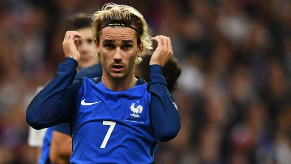 Antoine Griezmann scored one goal and set up another for Olivier Giroud as the 1998 champions topped European Group A.