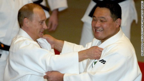 ST.PETERSBURG, RUSSIAN FEDERATION:  Russian Presidebt Vladimir Putin (L) demonstrates his judo skills to famous Japanese , Olympic judo champion Yasuhiro Yamashita (R) during their visit to a sports school in St. Petersburg, 24 December 2005. AFP PHOTO/ ALEXANDER NIKOLAYEV  (Photo credit should read ALEXANDER NIKOLAYEV/AFP/Getty Images)