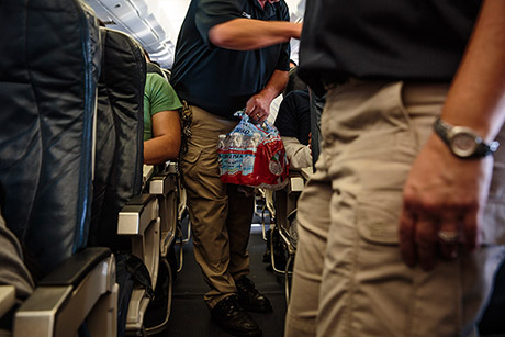 Deportees on the flight receive sandwiches, granola bars and bottled water.