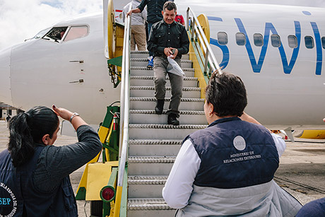 Guatemalan immigration officials meet deportees as they arrive, escorting them to a welcome center.