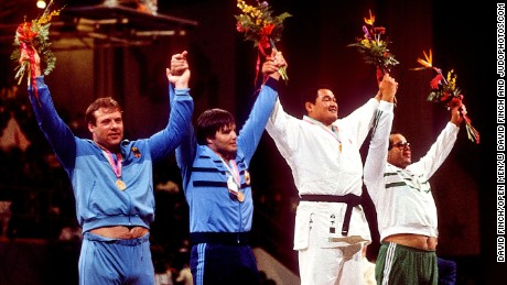 Yamashita stands proudly atop the podium alongside Egypt's Mohamed Ali Rashwan, Romania's Mihail Cioc and Arthur Schnabel of Germany.