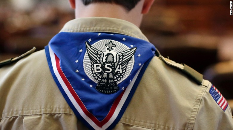 A Boy Scout wears an Eagle Scot neckerchief during the annual Boy Scouts Parade and Report to State in the House Chambers at the Texas State Capitol, Saturday, Feb. 2, 2013, in Austin, Texas. Perry says he hopes the Boy Scouts of America doesn't move soften its mandatory no-gays membership policy.