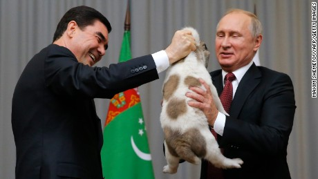 Turkmenistan's President Gurbanguly Berdimuhamedov presents a Turkmen shepherd dog to his Russian counterpart Vladimir Putin on October 11, 2017.