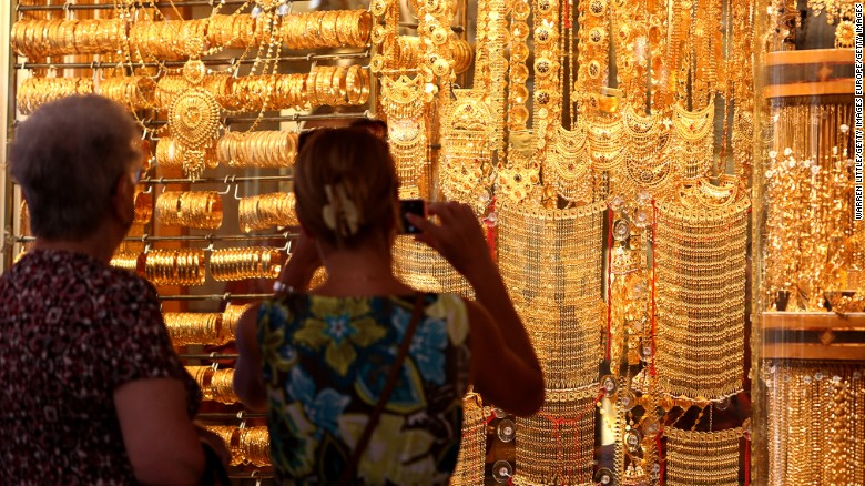 Visitors take pictures at the Dubai Gold Souk