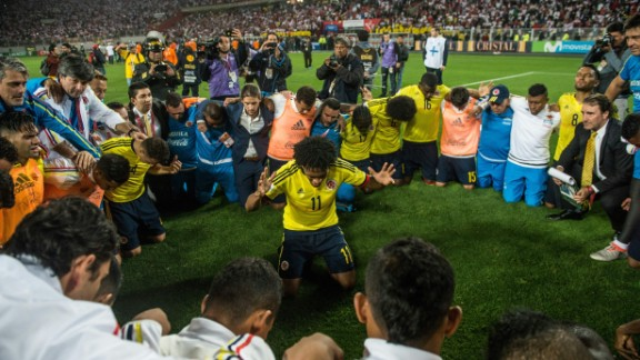 Colombia's Juan Cuadrado (C) leads a prayer after his team qualified for the 2018 World Cup following the 1-1 draw with with Peru in Lima. Colombia reached the quarterfinals in the 2014 tournament before losing 2-1 to hosts Brazil.
