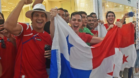 Panama's football team fans wave a national flag and cheer for their team in a mall in Panama City, a day after their national team qualified for the World Cup, for the first time ever, on October 11, 2017. Panama president Juan Carlos Varela declared a national holiday in celebration at the central American country's first ever qualification for the World Cup. / AFP PHOTO / RODRIGO ARANGUA        (Photo credit should read RODRIGO ARANGUA/AFP/Getty Images)