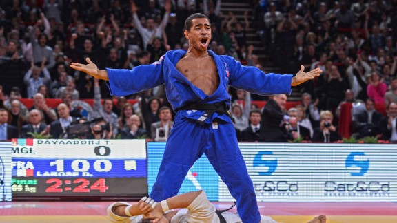 This image is in because I love working in Paris. The iconic Bercy Stadium (as it was called then) has the best public, atmosphere and energy of any tournament in the world. This picture is France's David Larose celebrating after winning the Paris Grand Slam in 2013. I love the story it tells: Larose ecstatic standing over a distraught Davaadorj Tumurkhuleg, the scoreboard reading ippon and the crowd going mad.