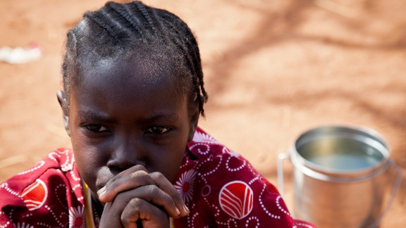 A girl from the Nuba Mountains in Sudan waits outside of the Yida refugee camp registration center in Yida, South Sudan on April 26, 2012. Thousands of people from the Nuba Mountains in South Kordofan, Sudan have fled to Yida to escape recent fighting and airstrikes by Sudan