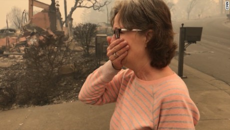 Homeowners cry as they return after fire