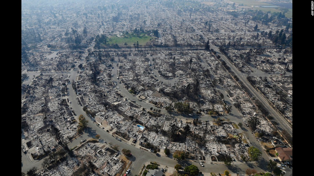 "Homes are destroyed in Santa Rosa, California, on Wednesday, October 11. <a href=""http://www.cnn.com/2017/10/09/us/gallery/santa-rosa-california-wildfires/index.html"" target=""_blank"">Deadly wildfires</a> have been tearing through the state, destroying homes and businesses and prompting evacuation orders. <a href=""http://www.cnn.com/interactive/2017/10/us/california-wildfires-cnnphotos/index.html"" target=""_blank"">In pictures: Wildfires ravage California's wine country</a>"