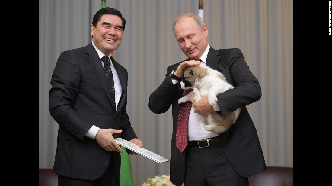 "Russian President Vladimir Putin pets a puppy that was given to him by Turkmenistan President Gurbanguly Berdimuhamedov, left, on Wednesday, October 11. It was <a href=""http://www.cnn.com/2017/10/11/world/russia-putin-birthday-puppy-trnd/index.html"" target=""_blank"">a belated birthday gift</a> for dog lover Putin, who was attending a summit in Sochi, Russia, along with Berdimuhamedov and other leaders of ex-Soviet nations."