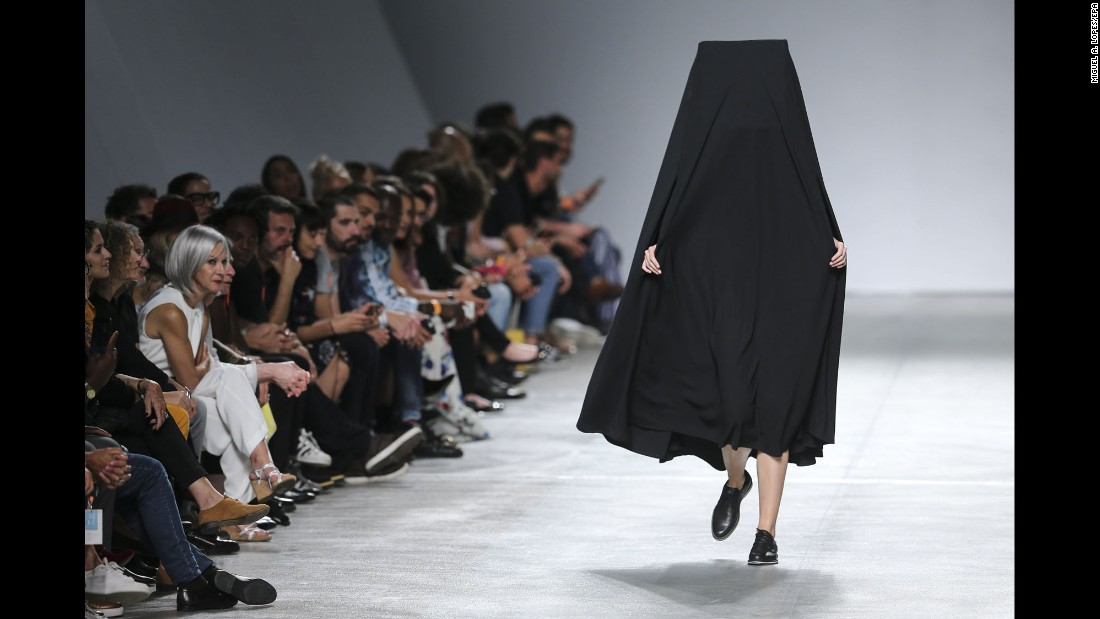 A model presents a creation by Portuguese designer Dino Alves during a fashion show in Lisbon, Portugal, on Saturday, October 7.