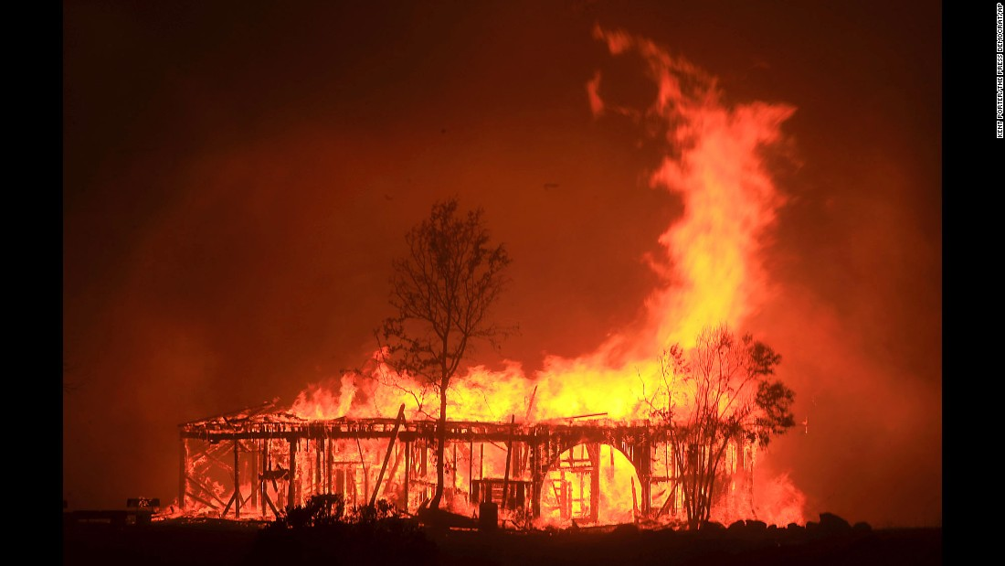 "A historic barn burns in Santa Rosa, California, on Monday, October 9. <a href=""http://www.cnn.com/interactive/2017/10/us/california-wildfires-cnnphotos/index.html"" target=""_blank"">Deadly wildfires</a> have forced thousands of Californians to flee to safety."