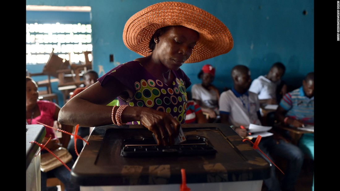 "A woman in Monrovia, Liberia, casts her ballot in <a href=""http://www.cnn.com/2017/10/10/africa/gallery/liberia-2017-elections/index.html"" target=""_blank"">the country's presidential election</a> on Tuesday, October 10."