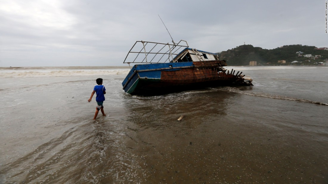 "A boy walks near a stranded boat in San Juan del Sur, Nicaragua, on Friday, October 6, after the passage of Tropical Storm Nate. Nate <a href=""http://www.cnn.com/2017/10/08/us/hurricane-nate-landfall/index.html"" target=""_blank"">carved a path of devastation</a> in Central America. At least 28 people were killed in Costa Rica, Nicaragua and Honduras. Hundreds were rescued from floodwaters and mudslides. Many lost power and running water."