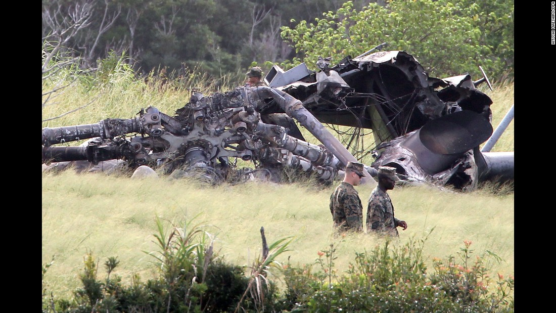 "US military personnel inspect the site where a helicopter burst into flames in Higashi, Japan, on Wednesday, October 11. US Marines <a href=""https://www.stripes.com/inflight-fire-sparks-super-stallion-s-emergency-landing-on-okinawa-officials-say-1.491947#.Wd_iTRNSwlI"" target=""_blank"">had to make an emergency landing</a> because of an in-flight fire, officials said. No injuries were reported."