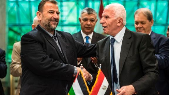 Fatah's Azzam al-Ahmad (R) and Saleh al-Aruri (L) of Hamas shake hands after signing a reconciliation deal in Cairo.