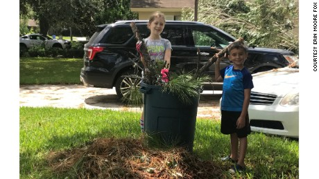 Madeline Fox, 9, and Jase Romano, 5, clean up in their Florida neighborhood after Hurricane Irma. The pair is raising money to help victims of the storm.