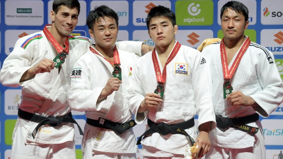 Here he stands (second from left) with, from left, silver medalist Rustam Orujov, South-Korean Changrim An and Mongolia's Odbayar Ganbaatar, who both won bronze.