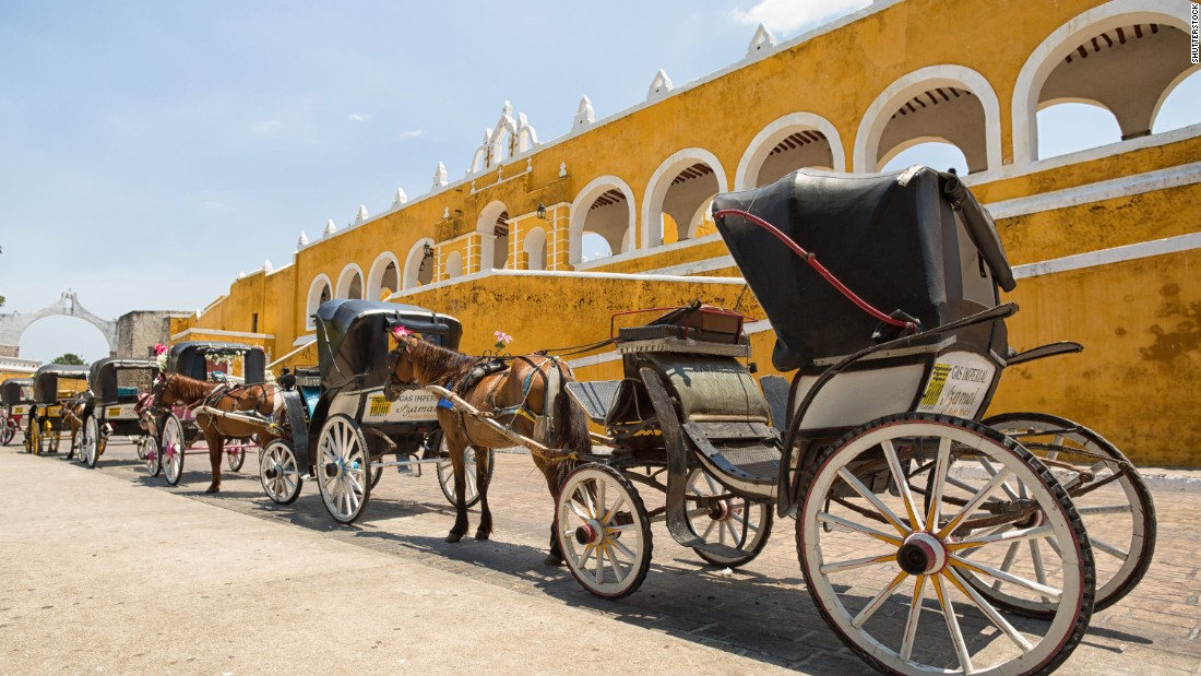 <strong>Izamal, Yucatán:</strong> This whole town, which centers around a 16th-century Franciscan monastery built on top of a Mesoamerican temple, is painted in a cheerful canary yellow.