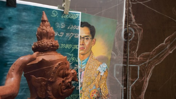 """An image of the king as a young man on display at a government art studio outside Bangkok. """"When we are working, we always think of His Majesty,"""" said sculptor Chatmongkol Insawang."""