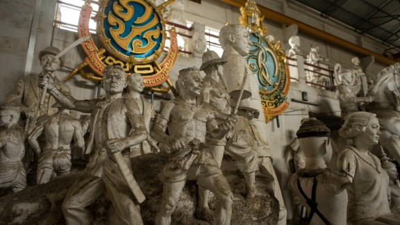 In addition to religious references, the artworks depict a variety of real-life figures and scenes from King Bhumibol's 70-year reign.