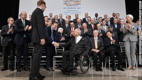 Finance Ministers and central bank governors greet Wolfgang Schaeuble (C), Germany's finance minister, as he arrives for the  the G20 Finance ministers group photo at the IMF  headquarters  in Washington, DC on October 12, 2017. / AFP PHOTO / ANDREW CABALLERO-REYNOLDS        (Photo credit should read ANDREW CABALLERO-REYNOLDS/AFP/Getty Images)