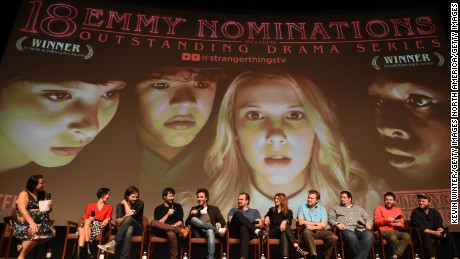 "LOS ANGELES, CA - AUGUST 17:  (L-R) Moderator Janelle Riley, Carmen Cuba, Matt Duffer, Ross Duffer, Shawn Levy, David Harbour, Nora Felder, Kevin Ross, Dean Zimmerman, Kyle Dixon and Michael Stein speak onstage at a reception and q&a for Netflix's ""Stranger Thing"" at the Directors Guild on August 17, 2017 in Los Angeles, California.  (Photo by Kevin Winter/Getty Images)"