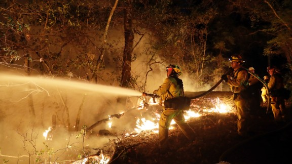 Firefighters battle a wildfire Saturday in Santa Rosa
