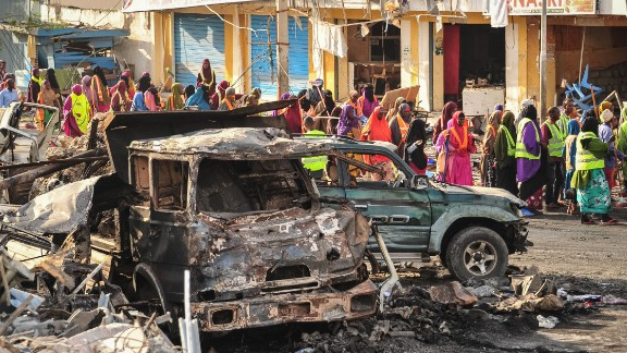 People gather near the scene of one of the bomb blasts that rocked Mogadishu in October.