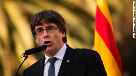 "Catalan regional government president Carles Puigdemont delivers a speech on the sidelines of a wreath-laying ceremony commemorating the 77th anniversary of the death of Catalan leader Lluis Companys at the Montjuic Cemetery in Barcelona on October 15, 2017. Companys had proclaimed a ""Catalan state in the Spanish federal republic"" in 1934 to oppose the conservatives who governed in Madrid. Exiled in France, Companys was denounced by the Nazis in 1940 and handed over to Spain where he was executed. / AFP PHOTO / PAU BARRENA        (Photo credit should read PAU BARRENA/AFP/Getty Images)"