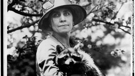 First Lady Grace Coolidge is seen holding her pet raccoon, Rebecca.