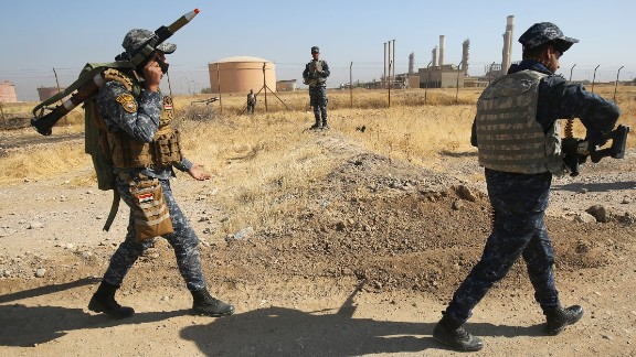 Iraqi forces walk past an oil production plant as they head towards the city of Kirkuk during an operation against Kurdish fighters on October 16, 2017.  Iraqi forces clashed with Kurdish fighters near the disputed city of Kirkuk, seizing a key military base and other territory in a major operation sparked by a controversial independence referendum. / AFP PHOTO / AHMAD AL-RUBAYE        (Photo credit should read AHMAD AL-RUBAYE/AFP/Getty Images)