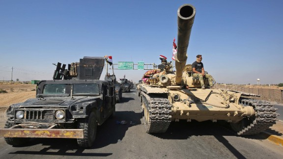Iraqi forces advance towards the city of Kirkuk during an operation against Kurdish fighters on October 16, 2017. Iraqi forces clashed with Kurdish fighters near the disputed city of Kirkuk, seizing a key military base and other territory in a major operation sparked by a controversial independence referendum. / AFP PHOTO / AHMAD AL-RUBAYE        (Photo credit should read AHMAD AL-RUBAYE/AFP/Getty Images)