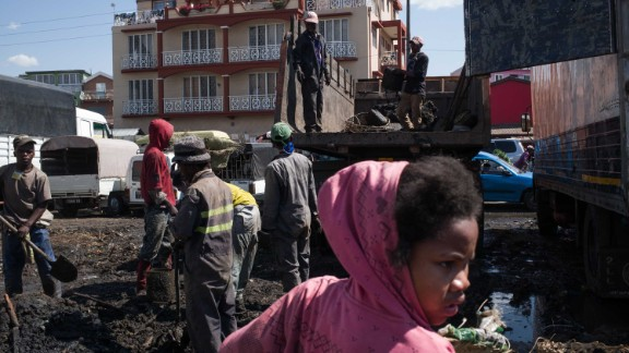 Council workers clear garbage during the clean-up of the market of Anosibe in Antananarivo. Rats are porters of fleas which spread the bubonic plague and are attracted by garbages and unsalubrity.
