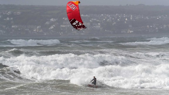 A man kite surfs in St Mount's Bay near Penzance, England, on October 16, 2017.