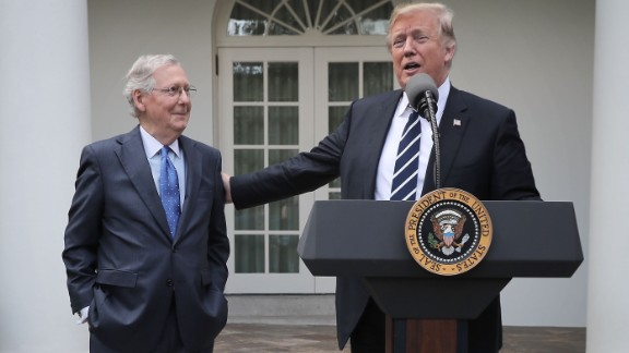 President Donald Trump (R) and Senate Majority Leader Mitch McConnell (R-KY) talk to reporters in the Rose Garden following a lunch meeting at the White House October 16, 2017 in Washington, DC.