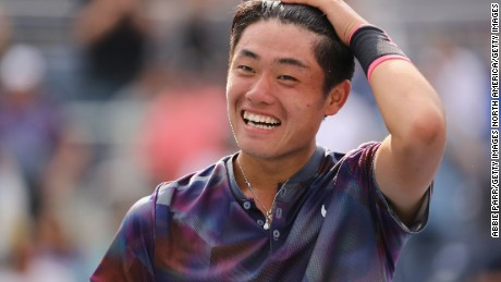 Wu  Yibing celebrates after winning China's first US Open boys' title.