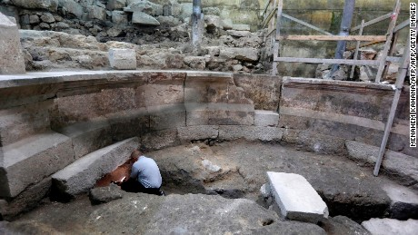 A journalist looks at part of a recently discovered ancient roman theatre from the second sanctuary that was found by the Israeli Antiquity Authority at the foot of the Western Wall tunnels in Jerusalem's Old City on October 16, 2017.  Excavations conducted by the Israel Antiquities Authority have uncovered large portions of the Western Wall that have been hidden for 1,700 years.  / AFP PHOTO / MENAHEM KAHANA        (Photo credit should read MENAHEM KAHANA/AFP/Getty Images)