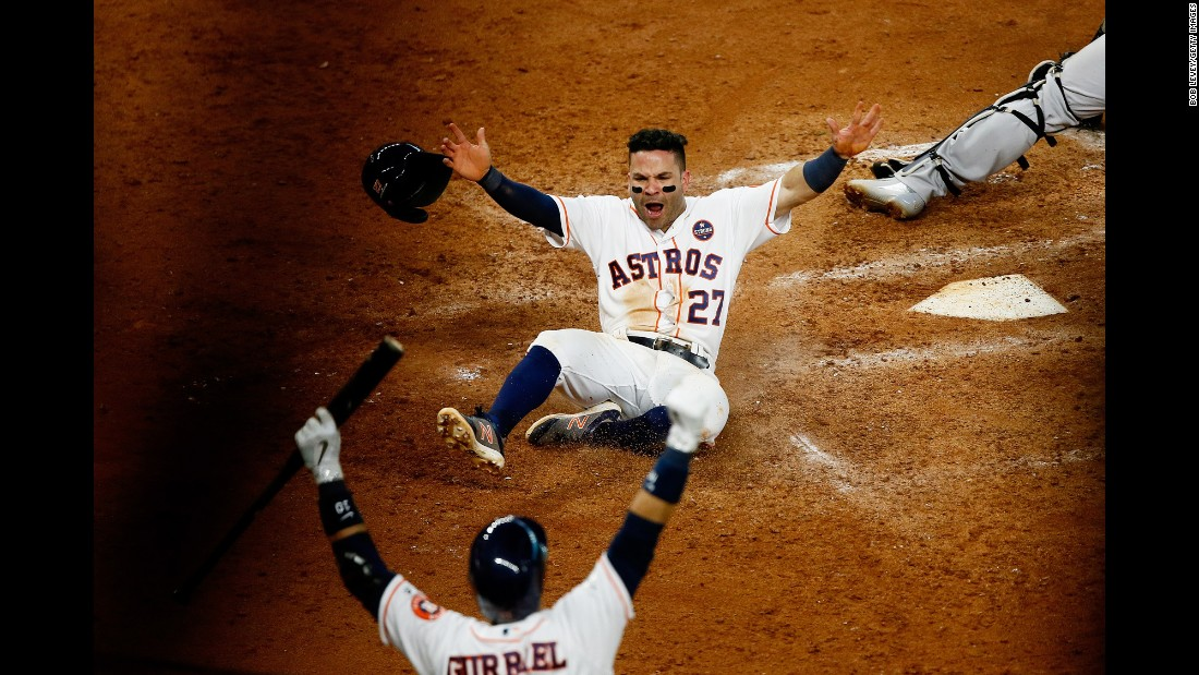 Houston Astros' Jose Altuve slides home to score the winning run against the New York Yankees in the ninth inning during Game Two of the American League Championship Series on Saturday, October 14, in Houston. The Astros defeated the Yankees 2 to 1.