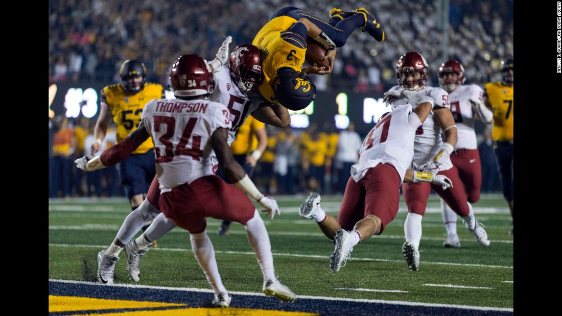 California Golden Bears quarterback Ross Bowers leaps for a touchdown against Washington State Cougars linebacker Justus Rogers during the second half at Memorial Stadium on Friday, October 13, in Berkeley, California.